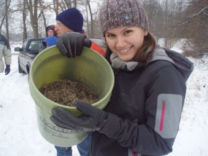 blueheronministries_badger-barrens-overseeding-2011_-julianne-seed-bucket
